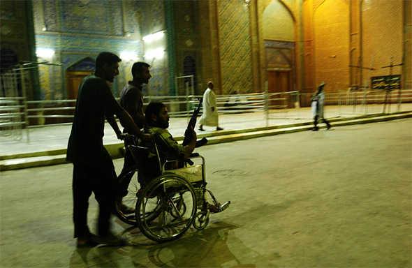 Night patrol outside the Imam Ali shrine